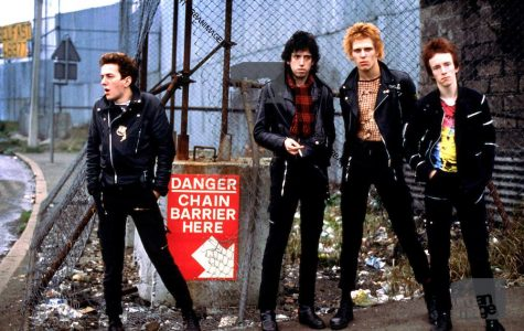 The Clash Mick Jones, Joe Strummer, Paul Simonon and Topper Headon photographed in Belfast, Northern Ireland 1977