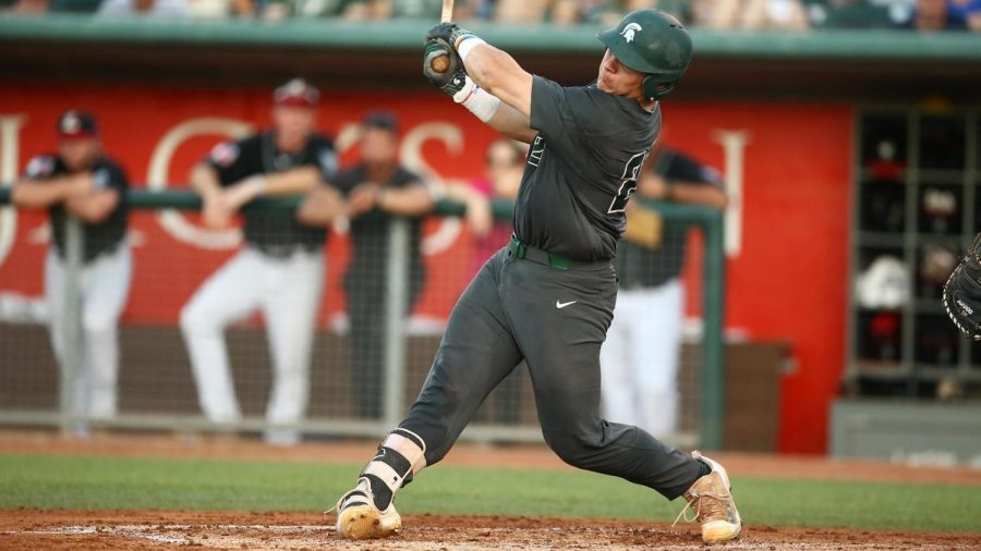 MSU catcher Adam Proctor swings at a pitch during a game/Photo Credit: MSU Athletic Communications