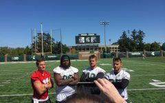 Brian Lewerke, Raequan Williams, Kenny Willekes, and Joe Bachie pose for a photo at media availability.