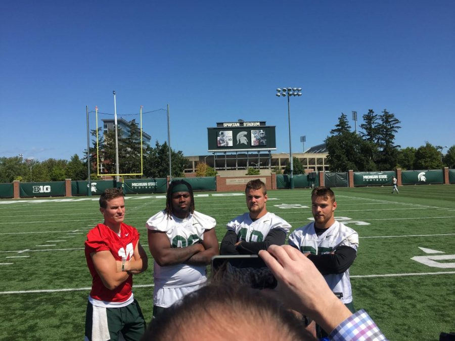Brian+Lewerke%2C+Raequan+Williams%2C+Kenny+Willekes%2C+and+Joe+Bachie+pose+for+a+photo+at+media+availability.+