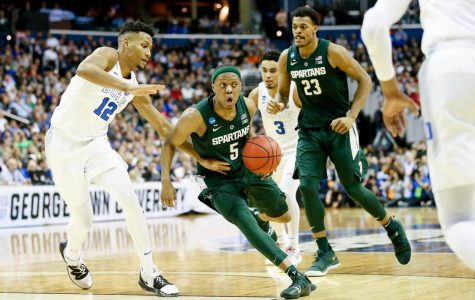 Winston's career game powers Spartans past Michigan