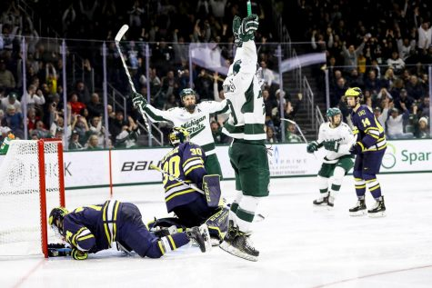 Wolverines blank Spartans in first game of rivalry series