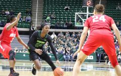 Nia Clouden dribbles against Ohio State/ Photo Credit: Ian Gilmour WDBM
