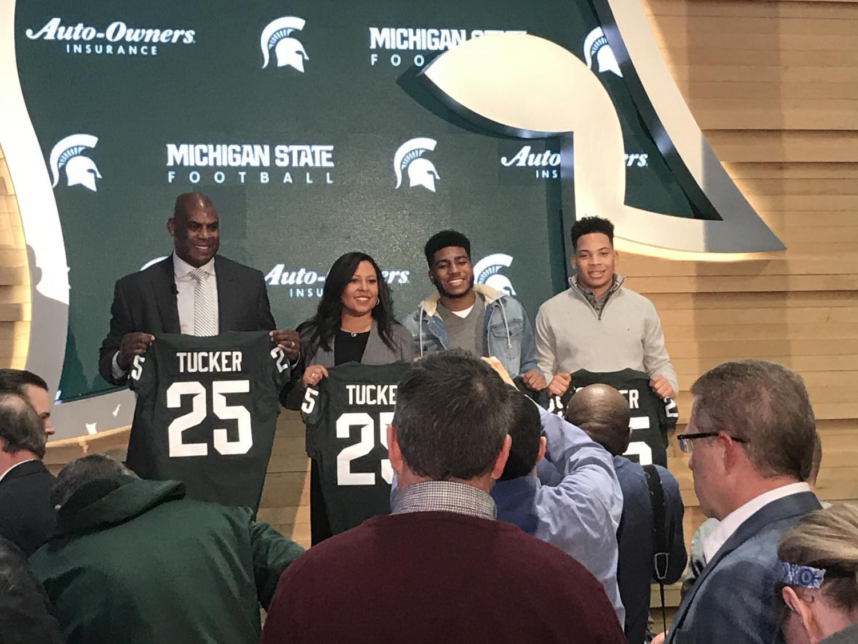 Mel Tucker is introduced as head coach of MSU football, alongside his family. (Credit: Alex McRae / WDBM)