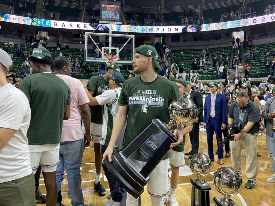 Kyle Ahrens poses with the Big Ten regular season title on Sunday, March 8, 2020. (Credit: Julian Mitchell / WDBM)