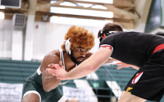 MSU wrestler Cameron Caffey grapples with an opponent/Photo: Michigan State Athletic Communications