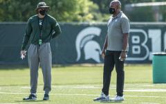 Mel Tucker talks with offensive coordinator Jay Johnson/Photo Credit: MSU Athletic Communications