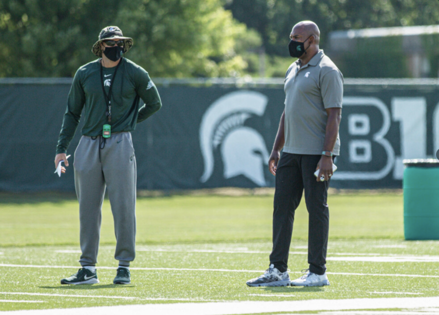 Mel Tucker talks with offensive coordinator Jay Johnson/Photo Credit: MSU Athletic Communications