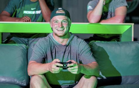Rocky Lombardi playing video games/Photo Credit:  MSU Athletic Communications