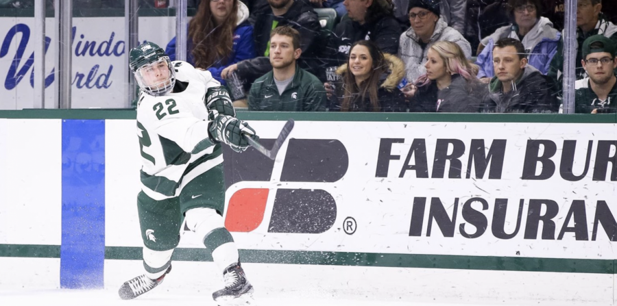 MSU defenseman Dennis Cesana redirects the puck out of the corner/ Photo Credit: MSU Athletic Communications