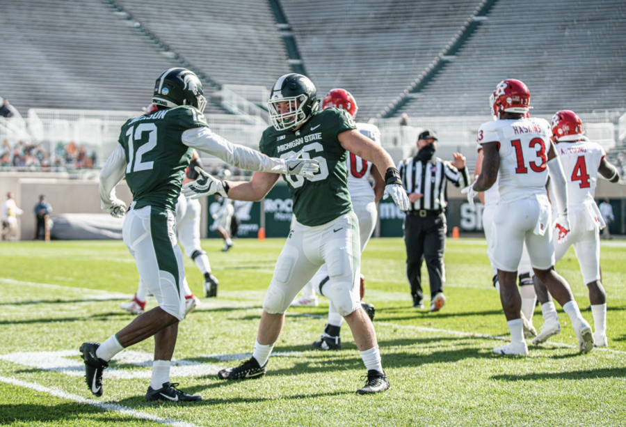 Chris Jackson and Drew Beesley high-five each other/ Photo Credit: MSU Athletic Communications