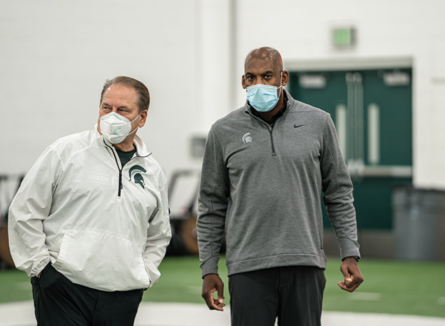 Tom Izzo and Mel Tucker talk during practice/ Photo Credit: MSU Athletic Communications