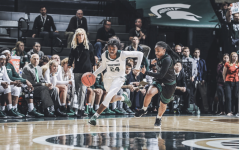 Nia Clouden sprints up the court against Eastern Michigan/ Photo Credit: MSU Athletic Communications