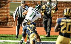 Connor Heyward scores in the flat against Michigan LB Josh Ross/ Photo Credit: MSU Athletic Communications