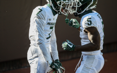 Ricky White and Jayden Reed celebrate White's first career touchdown/ Photo Credit: MSU Athletic Communications