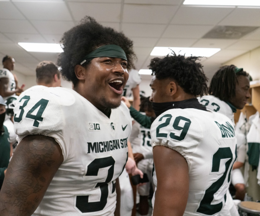 Antjuan+Simmons+and+Shakur+Brown+celebrate+beating+Michigan%2F+Photo+Credit%3A+MSU+Athletic+Communications
