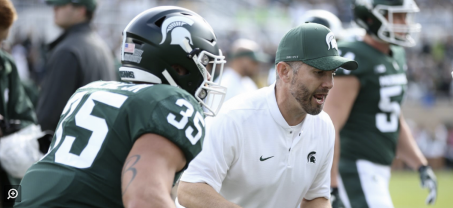 Michigan State safeties coach Mike Tressel supervises a drill/ Photo Credit: Michigan State Athletic Communications