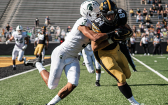 Xavier Henderson wraps up Iowa TE Sam LaPorta/ Photo Credit: MSU Athletic Communications