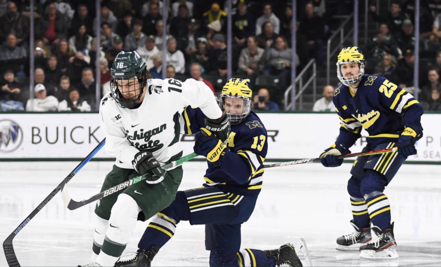 MSU F Brody Stevens battles for a puck against Michigan/ Photo Credit: MSU Athletic Communications