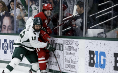 MSU defenseman Tommy Miller battles for the puck against Wisconsin/ Photo Credit: MSU Athletic Communications