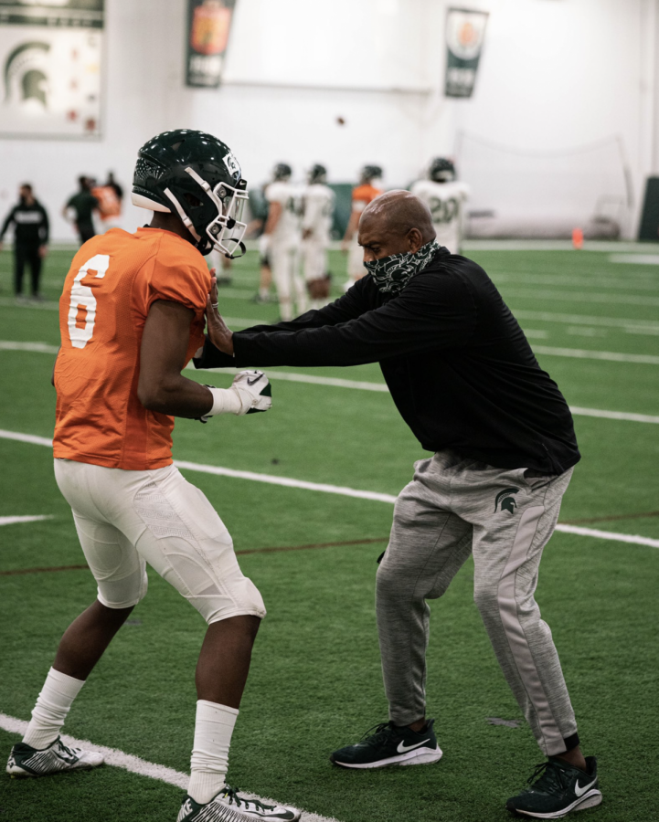 Mel Tucker instructs a player on proper hand usage/ Photo Credit: MSU Athletic Communications