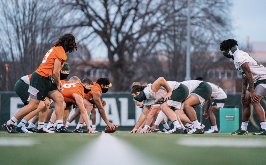 Michigan+State+practices+as+the+sun+goes+down%2F+Photo+Credit%3A+MSU+Athletic+Communications
