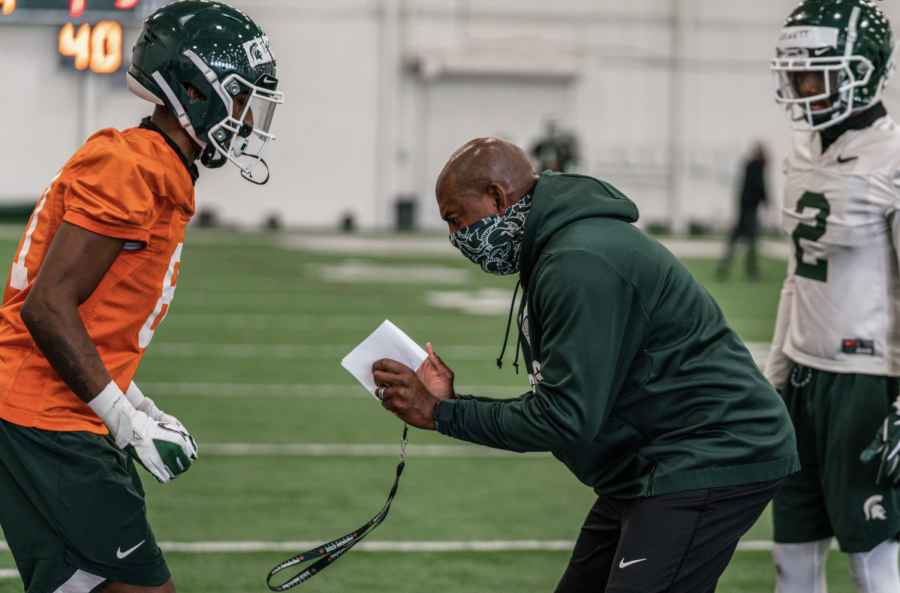 Mel Tucker coaches up a defensive back during practice/ Photo Credit: MSU Athletic Communications