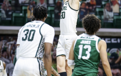 Joey Hauser forces a putback against Eastern Michigan/ Photo Credit: MSU Athletic Communications