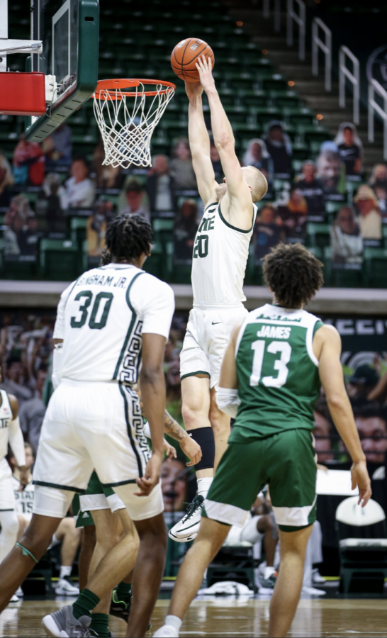 Joey+Hauser+forces+a+putback+against+Eastern+Michigan%2F+Photo+Credit%3A+MSU+Athletic+Communications%0A