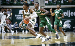 Aaron Henry brings the ball up the floor against Eastern Michigan/ Photo Credit: MSU Athletic Communications
