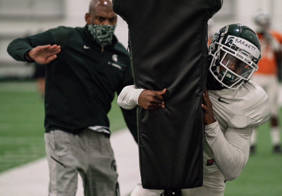Mel Tucker coaches CB Julian Barnett during practice/ Photo Credit: MSU Athletic Communications