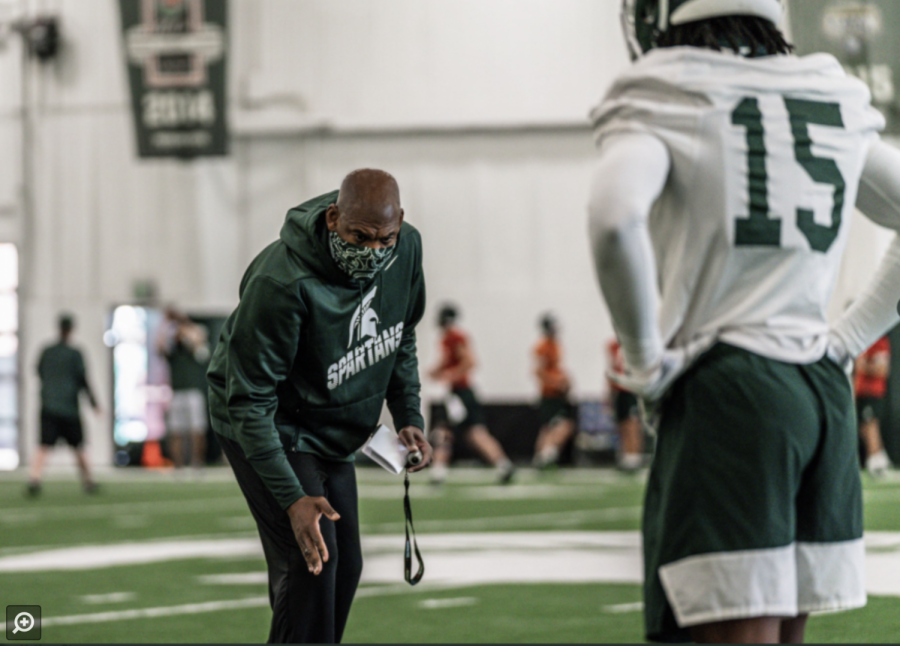 Mel+Tucker+gives+instructions+to+MSU+corner+Angelo+Grose+during+practice%2F+Photo+Credit%3A+MSU+Athletic+Communications