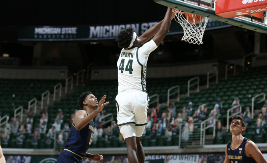 Gabe Brown skies for a dunk vs. Notre Dame/ Photo credit: MSU Athletic Communications