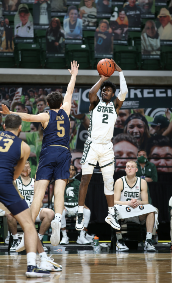 Rocket Watts attempt a jump shot over Notre Dame G Cormac Ryan/ Photo Credit: MSU Athletic Communications