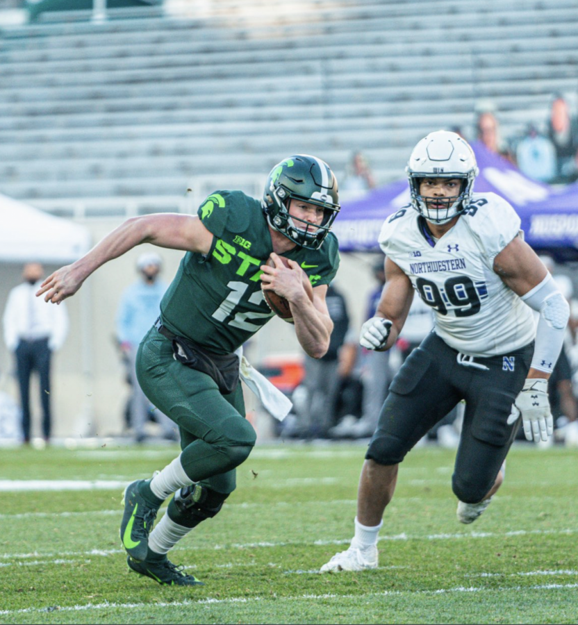 Rocky Lombardi rushes against Northwestern/ Photo Credit: MSU Athletic Communications