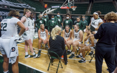 Suzy Merchant talks to her team inside the huddle/ Photo Credit: MSU Athletic Communications