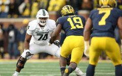 Michigan State offensive lineman Devontae Dobbs against Michigan defensive lineman Kwity Paye (Photo: MSU Athletic Communications)