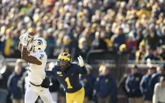 MSU WR/CB Julian Barnett makes a catch against Michigan CB Ambry Thomas/ Photo Credit: MSU Athletic Communications