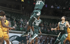 Gabe Brown skies for a baseline dunk/ Photo Credit: MSU Athletic Communications