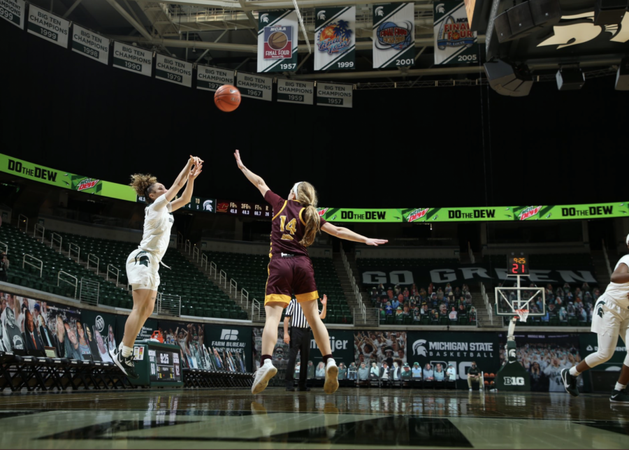 Alyza Winston attempts a jumper against CMU G  Molly Davis/ Photo Credit: MSU Athletic Communications