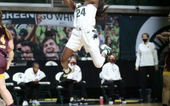 Nia Clouden attempts a layup under the net against Central Michigan/ Photo Credit: MSU Athletic Communications