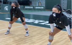 MSU defensive specialists Jamye Cox and Talia Edmonds practice at Jenison Fieldhouse/ Photo Credit: MSU Athletic Communications