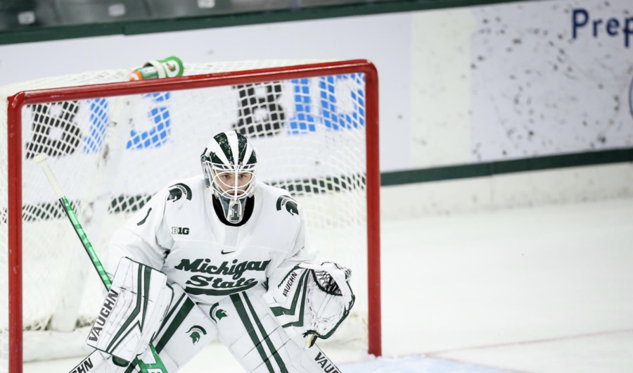 Spartan goaltender Drew DeRidder stands between the pipes during a game/ Photo Credit: MSU Athletic Communications