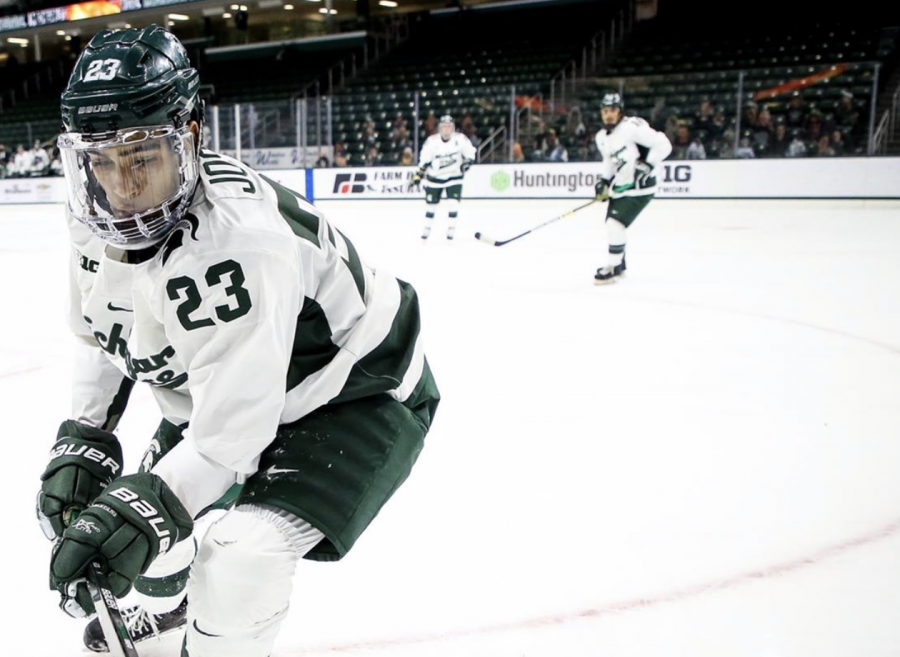MSU+F+Jagger+Joshua+tracks+down+a+puck+in+the+corner%2F+Photo+Credit%3A+MSU+Athletic+Communications
