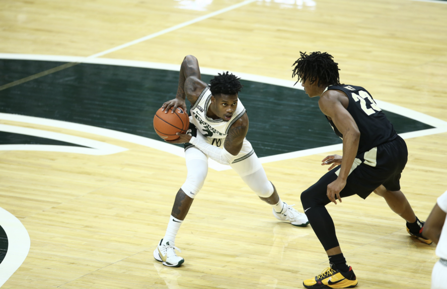 Rocket+Watts+tries+to+dribble+past+Purdue+G+Jaden+Ivey%2F+Photo+Credit%3A+MSU+Athletic+Communications%0A%0A
