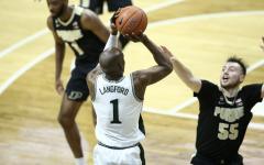 Joshua Langford attempts a 3-pointer over Purdue G Sasha Stevanovic/ Photo Credit: MSU Athletic Communications