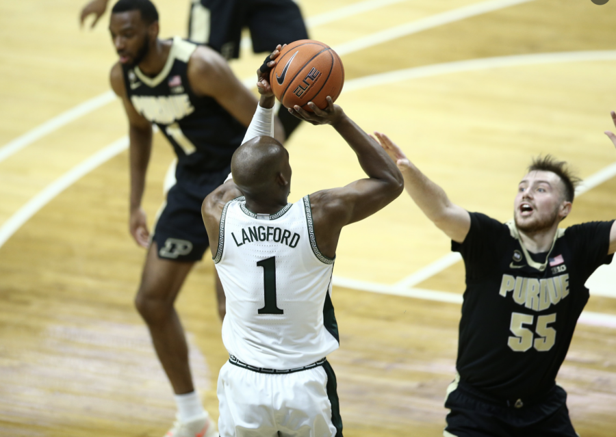 Joshua Langford attempts a 3-pointer over Purdue G Sasha Stevanovic/ Photo Credit: MSU Athletic Communications