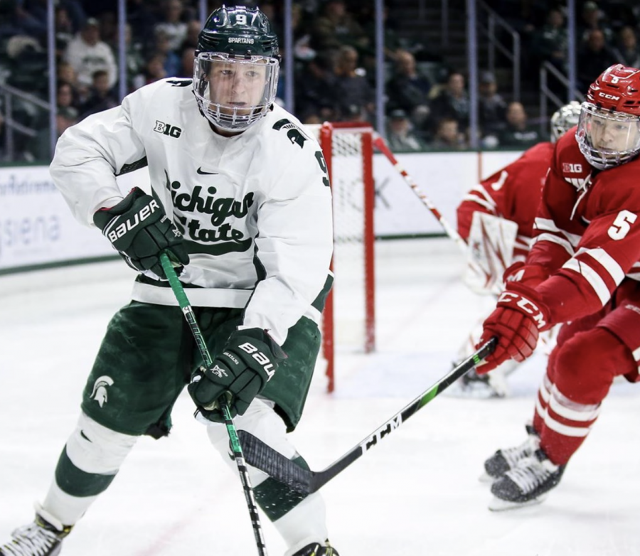 MSU F Mitchell Lewandowski goes after a puck against Wisconsin/ Photo Credit: MSU Athletic Communications