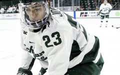 MSU forward Jagger Joshua chases down a puck in the corner/ Photo Credit: MSU Athletic Communications