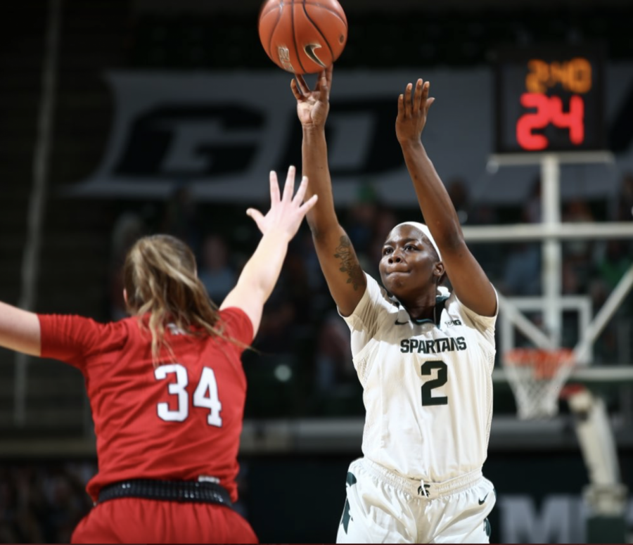 Mardekia Cook attempts a shot over Nebraska forward Isabelle Bourne/ Photo Credit: MSU Athletic Communications
